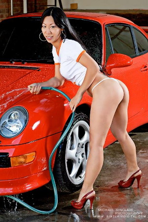 Tia Ling washing her car